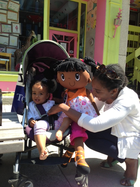 Happy customers at Montréal's Oink Oink Toy Store with My Friend Huggles Rubi Doll